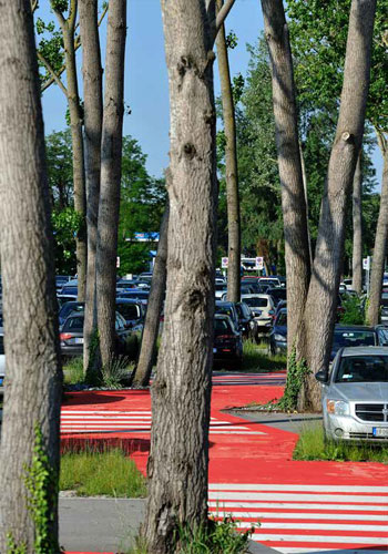 "Infrastructure: Marco Polo Airport Car Park in Tessera, Italy (MADE associates) incorporates mature trees, porous pavers, and a ""graphic soil"" to propose that parking lots ""can be locally specific, visually engaging, ecologically productive, and verdant."" / MADE associates"