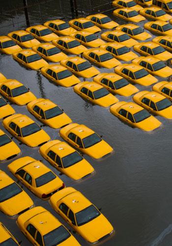 Taxis submerged in nine feet of water during Hurricane Sandy / Alan Blumberg