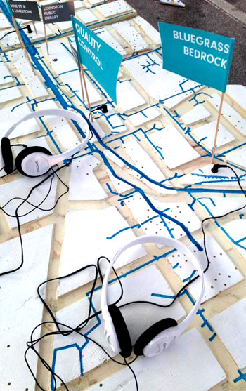 Headphones and maps set up for a Water Walk event in Lexington, Kentucky / Gena Wirth