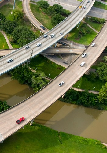 Busy freeway flyovers above Buffalo Bayou Park near Downtown Houston / SWA Group