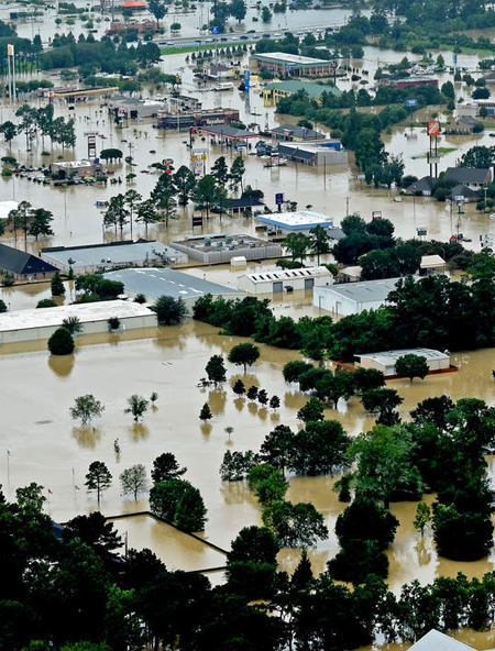 Flood damage in Denham Springs / Patrick Dennis/The Advocate, via Associated Press